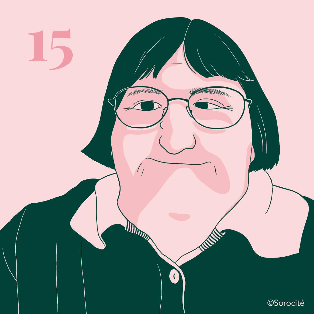 La militante Melissa Blake en format portrait, cheveux coupés au carré avec des grandes lunettes légèrement ovales. Le numéro 15 à gauche de sa tête.