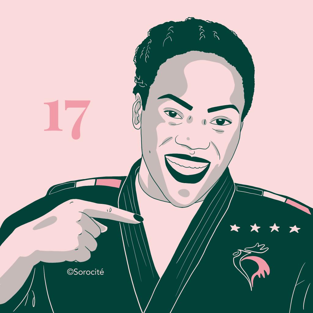 Clarisse Agbégnénou en format portrait, en tenue de judo montrant quatre étoiles de championne avec le sourire.