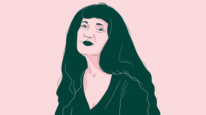 Marie-Cécile Naves cheveux longs et brun lâchés sur les épaules en format portrait